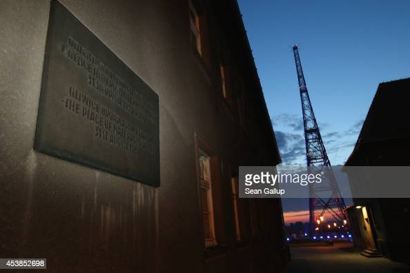 A plaque commemorates the 'Gleiwitz Incident' at twilight at the former radio station building as the former radio broadcast tower stands nearby on...