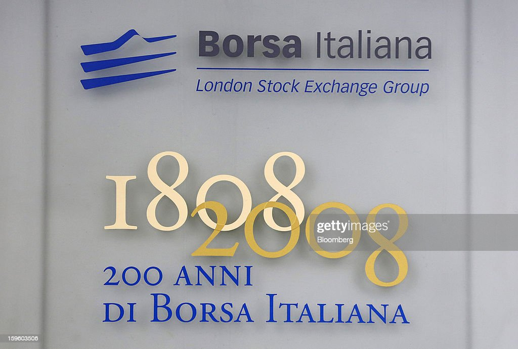 A plaque commemorating the 200th anniversary of the Borsa Italiana, sits on a wall inside Italy's stock exchange, which is part of the London Stock Exchange Group Plc, in Milan, Italy, on Thursday, Jan. 17, 2013. The euro-area economy won't return to growth until the next quarter as a recovery in Italy is delayed and France continues to shrink, according to a survey of economists. Photographer: Alessia Pierdomenico/Bloomberg via Getty Images