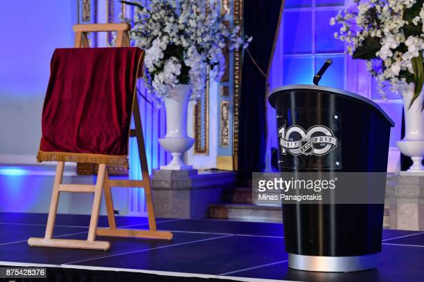 A plaque commemorating the Centennial birthday of the National Hockey League is covered near the podium during the NHL Centennial 100 Celebration at...