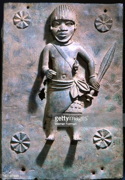 A plaque depicting a Benin warrior which decorated the palace of the Oba Nigeria Edo probably 17th Century Benin City