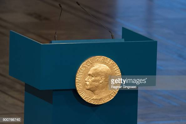 A plaque depicting Alfred Nobel adorns the lecturn prior to The the Nobel Peace Prize Ceremony at Oslo City Town Hall on December 10 2015 in Oslo...