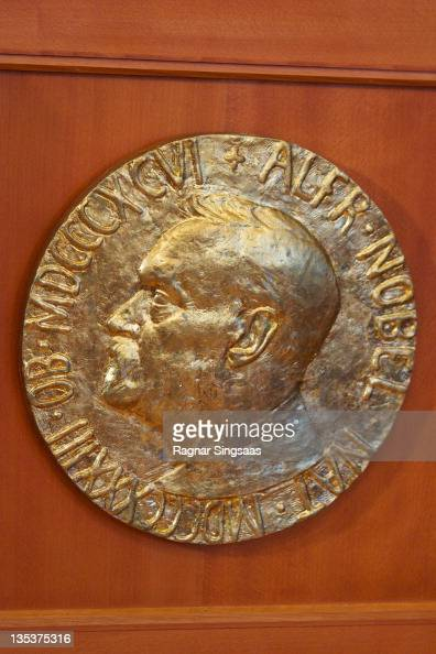 A plaque depicting Alfred Nobel is seen on the wall during the Nobel Peace Prize ceremony at The Norwegian Nobel Institute on December 9 2011 in Oslo...
