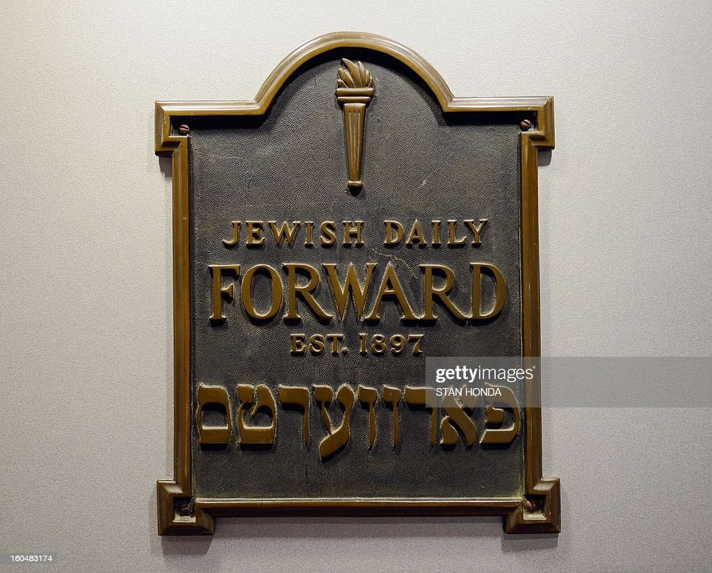 A plaque from the original Daily Forward office located on Broadway is seen February 1, 2013 in the newspapers' latest office in the Lower Manhattan section of New York. A redesigned Yiddish website, part of the 115-year old Jewish newspaper, will be launched on February 4. AFP PHOTO/Stan HONDA