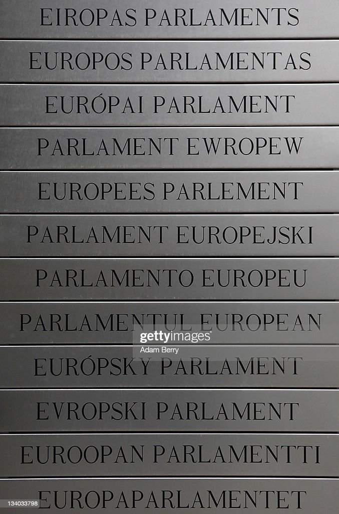 A plaque lists the words 'European Parliament' written in the languages of its 27 member countries outside the Parliament's building on November 22, 2011 in Brussels, Belgium. Eurozone member countries are continuing to struggle with a debt crisis afflicting a widening circle of nations as the rest of the world fears economic repurcussions.