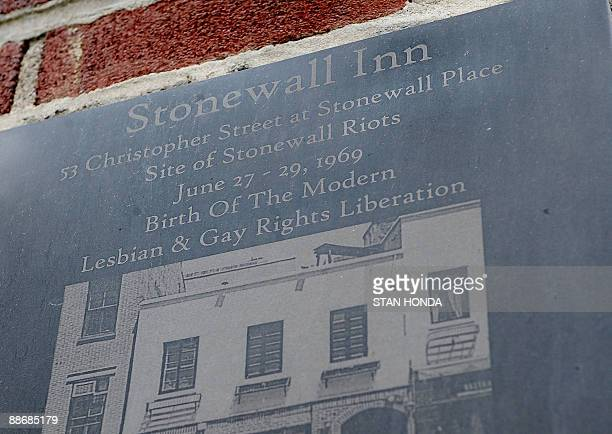 A plaque marks the site of the Stonewall riots at the Stonewall Inn on Christopher Street June 23 2009 in the Greenwich Village section of New York...