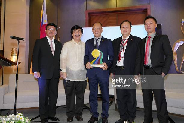 Plaque of appreciation is given to Sec Diokno by Andy Que Chairman of Mahal Ko Mindanao Inc Mahal Ko Mindanao Inc coorganized Global Investment Forum...