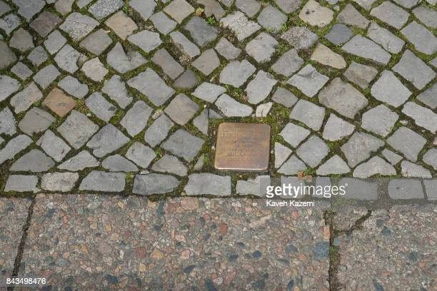 A plaque placed on the pavement in front of a home where a Jewish woman by the name Bertha Van Damm lived and was deported on September 14 1942 when...
