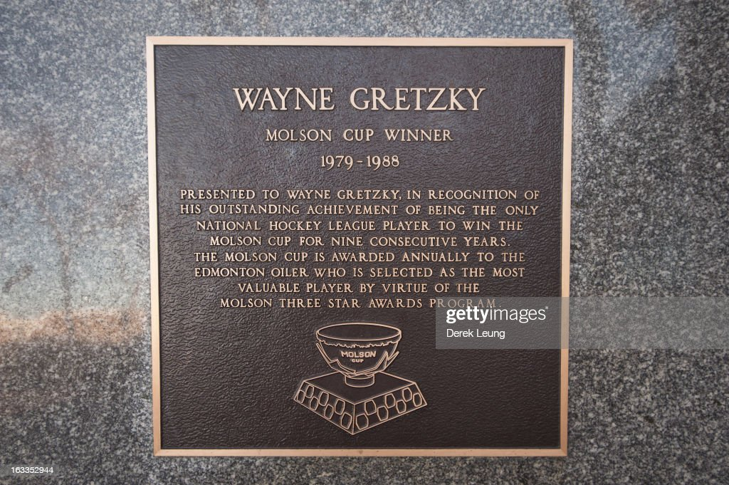 A plaque recognizing Wayne Gretzky mounted onto a statue of Wayne Gretzky as photographed before an NHL game between the Edmonton Oilers and the Phoenix Coyotes at Rexall Place on February 23, 2013 in Edmonton, Alberta, Canada.