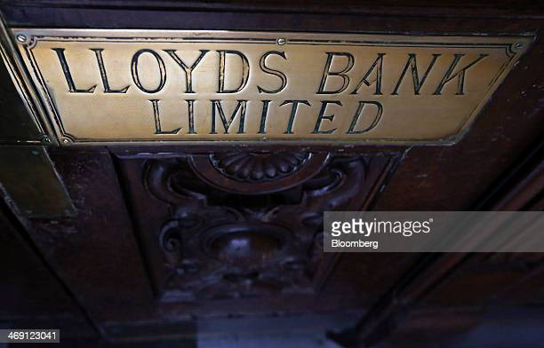 A plaque sits outside a Lloyds Bank branch a unit of Lloyds Banking Group Plc in London UK on Thursday Feb 13 2014 Lloyds Banking Group Plc Britain's...