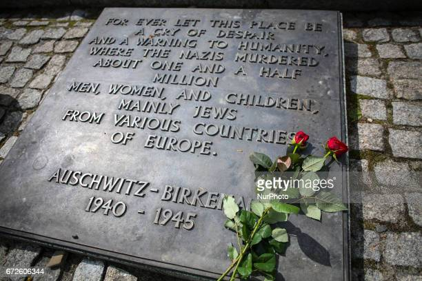 Plaque with English words at International Monument at the former NaziGerman Auschwitz Birkenau concentration and extermination camp at Oswiecim...