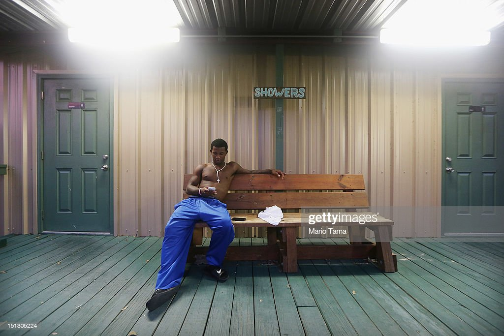 Plaquemines Parish resident Lennix Harvey sits in the Camp Hope shelter after evacuating prior to Hurricane Isaac on September 5, 2012 in Arabi, Louisiana. Louisiana officials estimate that at least 13,000 homes were damaged by Hurricane Isaac.