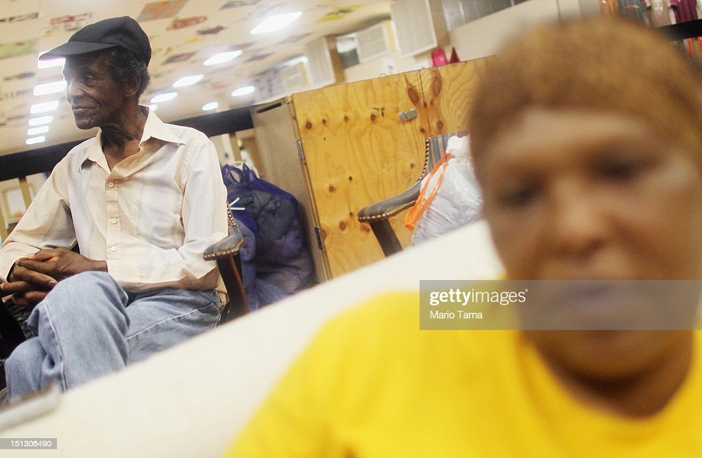Plaquemines Parish residents Chester Wilson (L) and June DeMolle sit in the Camp Hope shelter after evacuating prior to Hurricane Isaac on September 5, 2012 in Arabi, Louisiana. Louisiana officials estimate that at least 13,000 homes were damaged by Hurricane Isaac.