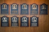 Plaques of members of the Boston Red Sox Hall of Fame on a wall during the Opening Day game between the Boston Red Sox and the Tampa Bay Rays on...