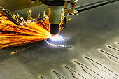 CNC plasma cutting machine during operation. Processing of the steel sheet.