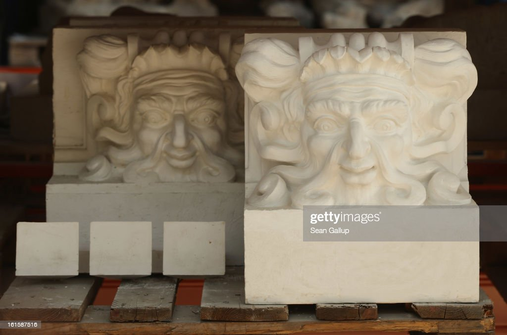 Plaster cast details that a scultor will use to copy into stone lie on shelves at the Schlossbauhuette studio where a team of sculptors is creating decorative elements for the facade of the Berliner Schloss city palace on February 12, 2013 in Berlin, Germany. The Berliner Schloss was the residence of the Prussian Kaiser and was among the major architectural landmarks of Berlin until it was heavily damaged by Allied bombing in 1945. The communist authorities of East Berlin demolished the building in the 1950s, and today's Berlin government is pursuing an ambitious project to rebuild the palace according to a design by Italian architect Franco Stella, which will recreate the facade of the building but with a modern interior at a cost of approximately EUR 590 million. The Humboldt Forum, the foundation leading the project, has given the Schlossbauhuette sculptors the formidable task of recreating the hundreds of architectural elements that decorated the facade, and though some original pieces were saved, more often the sculptors have only old black and white photos as reference.