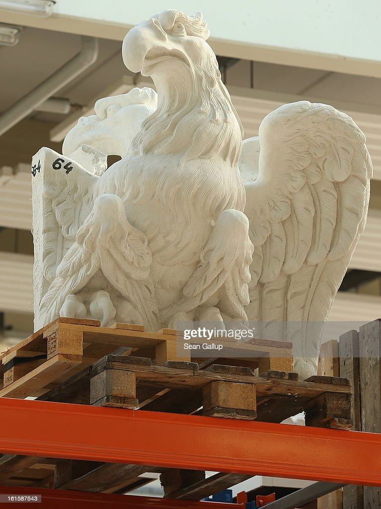 A plaster cast eagle that a sculptor will use to copy into stone stands on a shelf at the Schlossbauhuette studio where a team of sculptors is creating decorative elements for the facade of the Berliner Schloss city palace on February 12, 2013 in Berlin, Germany. The Berliner Schloss was the residence of the Prussian Kaiser and was among the major architectural landmarks of Berlin until it was heavily damaged by Allied bombing in 1945. The communist authorities of East Berlin demolished the building in the 1950s, and today's Berlin government is pursuing an ambitious project to rebuild the palace according to a design by Italian architect Franco Stella, which will recreate the facade of the building but with a modern interior at a cost of approximately EUR 590 million. The Humboldt Forum, the foundation leading the project, has given the Schlossbauhuette sculptors the formidable task of recreating the hundreds of architectural elements that decorated the facade, and though some original pieces were saved, more often the sculptors have only old black and white photos as reference.