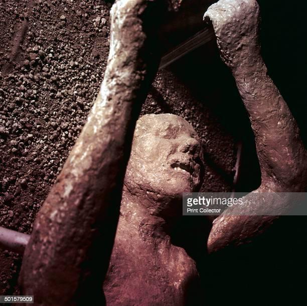 Plaster cast of a victim of the eruption of Vesuvius at Pompeii Italy