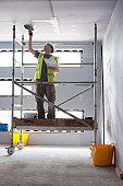Plasterer in new construction