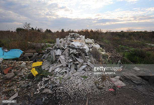 Plastic and asbestos are left strewn on the sides of an agriculture field near Orta di Atella southern Italy on November 14 2013 Orta di Atella is...