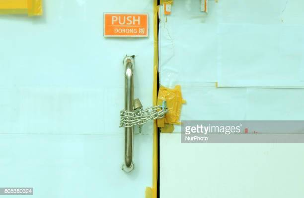 plastic and paper cover glass by using chain locks at 7 eleven broke retail outlets in Jakarta Indonesia on June 302017 The Indonesia Stock Exchange...
