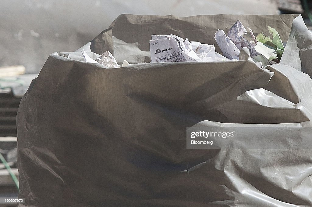 A plastic bag filled with recovered documents sits outside Petroleos Mexicanos (Pemex) administrative building in Mexico City, Mexico, on Sunday, Feb. 3, 2013. The search for the cause of a blast that destroyed three floors of a building at Pemex' headquarters and killed at least 34 people entered a fourth day, as investigators toiled ahead of a self-imposed deadline for finding an answer. Photographer: Susana Gonzalez/Bloomberg via Getty Images