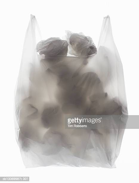 Plastic bag full of crumbled up plastic bags and backlit, close-up