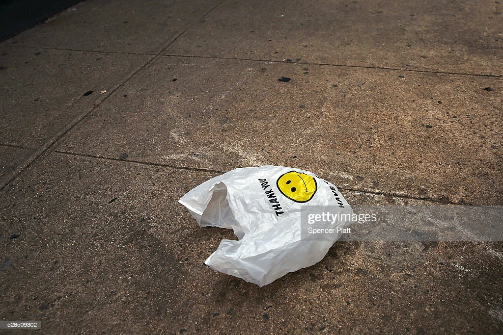 A plastic bag sits in a Manhattan street on May 05, 2016 in New York City. New York's City Council is scheduled to vote Thursday on a bill that would require most stores to charge five cents per bag in an effort to cut down on plastic waste. New York's sanitation department estimates that every year 10 billion bags are thrown in the trash.