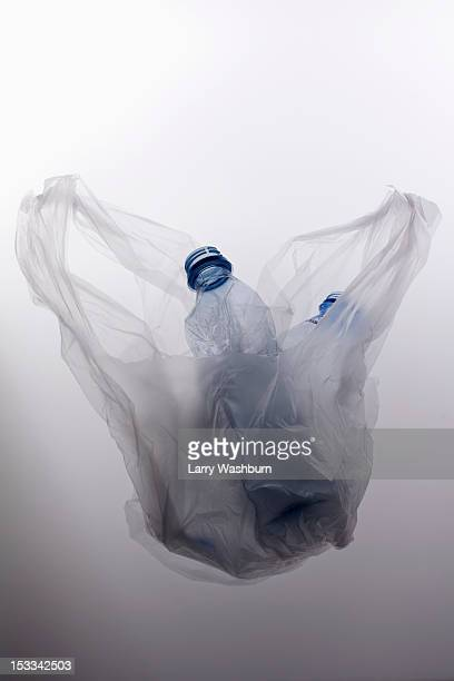 A plastic bag with two empty plastic water bottles