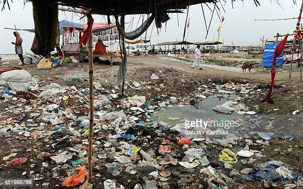 Plastic bags and garbage litter the banks of the River Ganges at Sangam in Allahabad on July 10 2014 The Ganges suffers from extreme pollution levels...