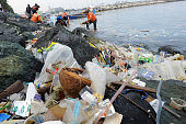 Plastic bags and other rubbish are collected from the waters and shoreline of Manila Bay on July 3 2014 during a campaign by environmental activists...