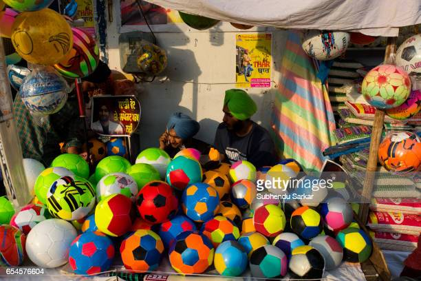 Plastic balls are on sale at a temporary stall Hola Mohalla festival Hola Mohalla is a threeday festival started by the tenth Sikh Guru Govind Singh...