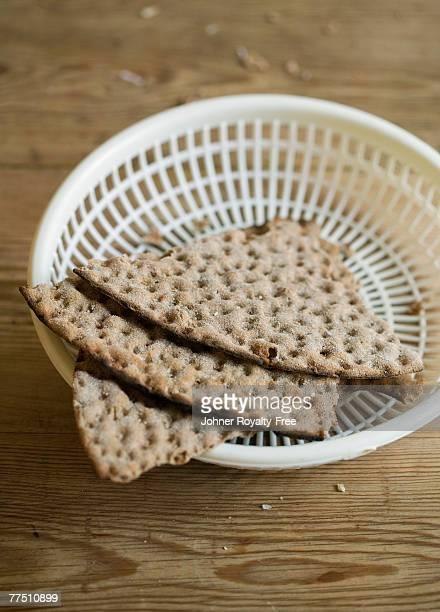 A plastic basket with crisp bread.