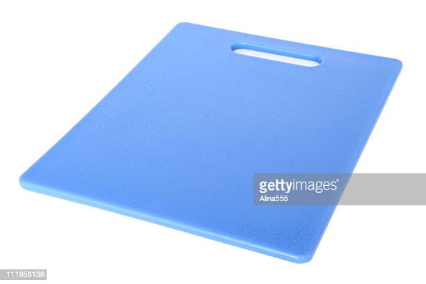 Plastic blue cutting board on white