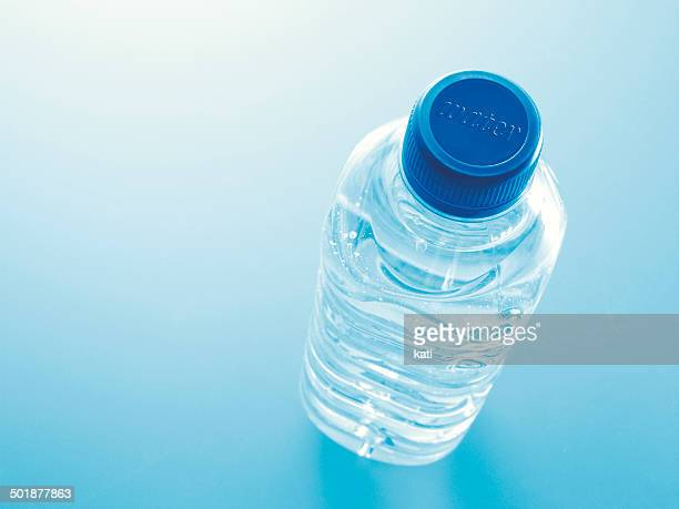 Plastic bottle filled with water with the word water on the lid