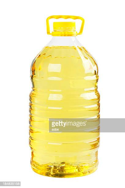 Plastic bottle of oil with yellow lid and handle