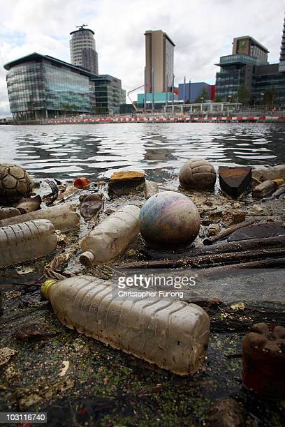 Plastic bottles footballs and floating rubbish pollutes Manchester Ship Canal at Salford Quays on July 27 2010 in Salford England