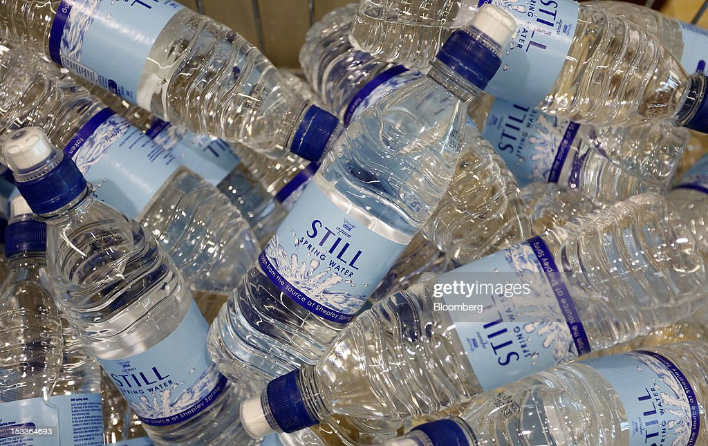 Plastic bottles of still water sit on display at a supermarket operated by Aldi Group, Germany's biggest discount-food retailer, in Manchester, U.K., on Thursday, Oct. 4, 2012. U.K. shop-price inflation slowed in September as retailers offered discounts to attract cash-strapped consumers, the British Retail Consortium said. Photographer: Paul Thomas/Bloomberg via Getty Images
