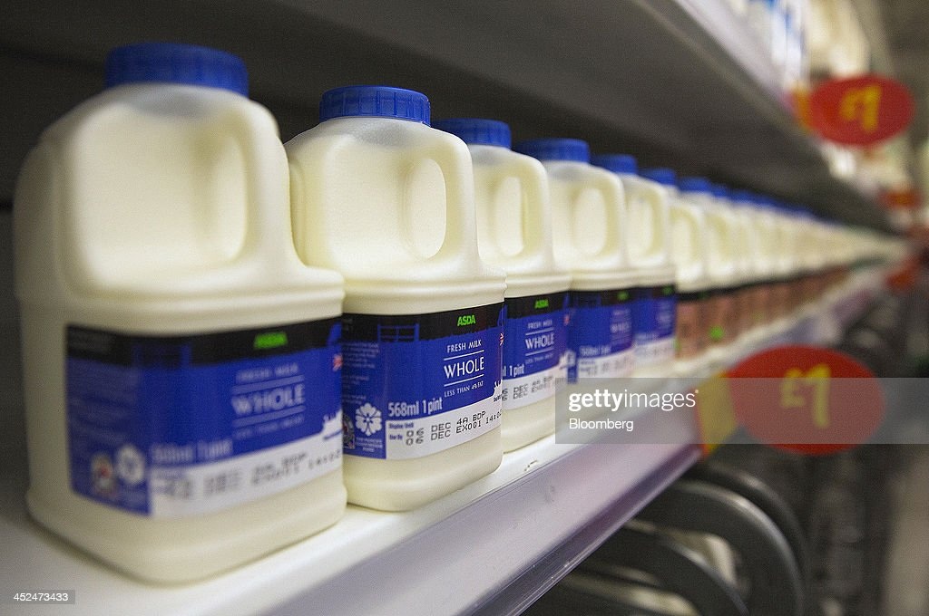 Plastic bottles of whole milk sits displayed for sale in the chilled goods section of an Asda supermarket in Wembley, London, U.K., on Friday, Nov. 29, 2013. Britons queued outside Asda supermarkets this morning and charged into stores when doors opened at 8 a.m. as the U.K. grocery chain took on the Black Friday mantle from U.S. owner Wal-Mart Stores Inc. Photographer: Simon Dawson/Bloomberg via Getty Images