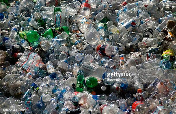 Plastic bottles sit in piles at the Miramar Recycling facility in San Diego California US on Monday Aug 13 2012 Miramar Landfill an environmentally...