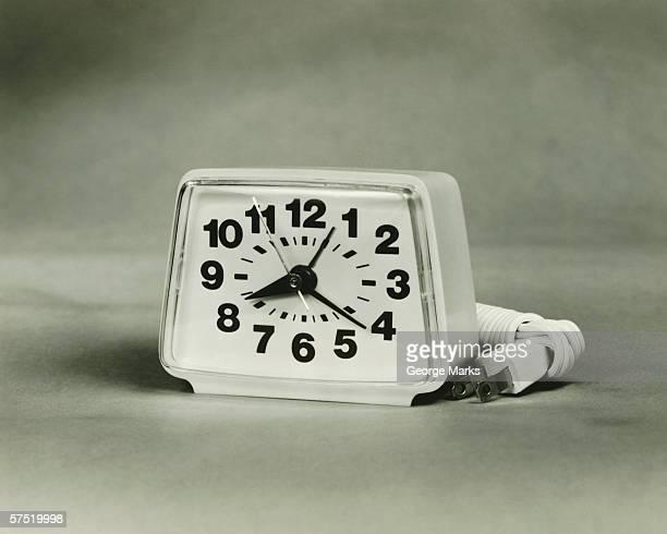 Plastic cased electric alarm clock, (B&W), close-up