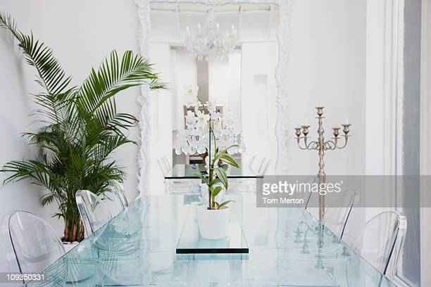 Plastic chairs and table in modern dining room