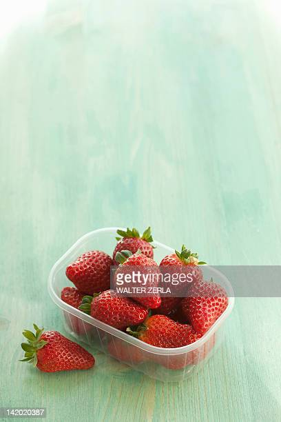 Plastic container of strawberries