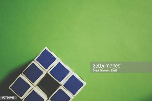 Plastic Cube On Green Surface