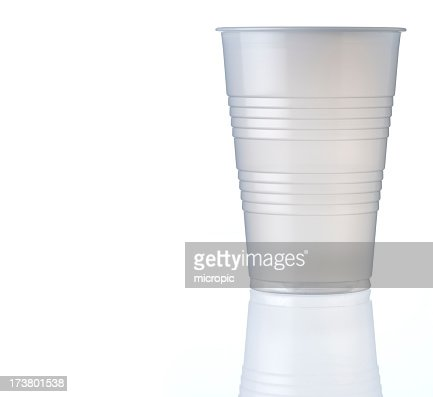 Plastic cup and partial reflection on white background