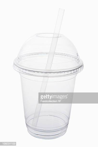 Plastic cup with straw, close-up