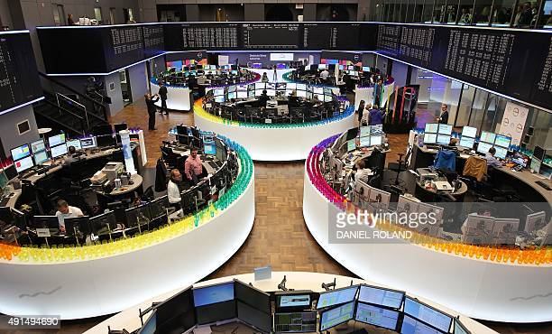 Plastic cups of Covestro stand around the working desks of traders at the stock exchange in Frankfurt am Main western Germany where Covestro's...
