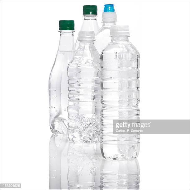 Plastic drinking bottles on white background