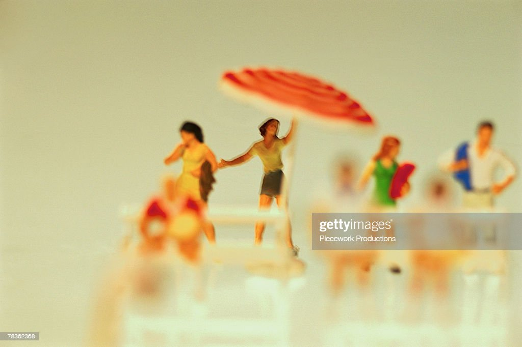 Plastic figurines at beach : Stock Photo