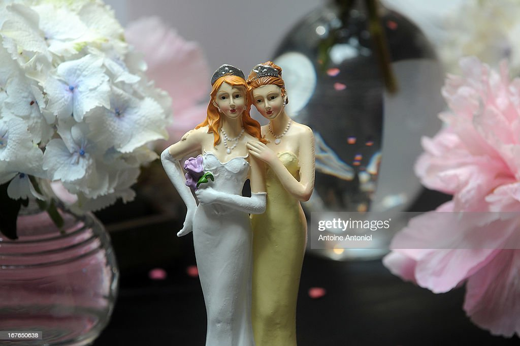 Plastic figurines of same-sex couples are displayed at the gay marriage show on April 27, 2013 in Paris, France. The show takes place four days after France legalised same-sex marriage at the National Assembly.
