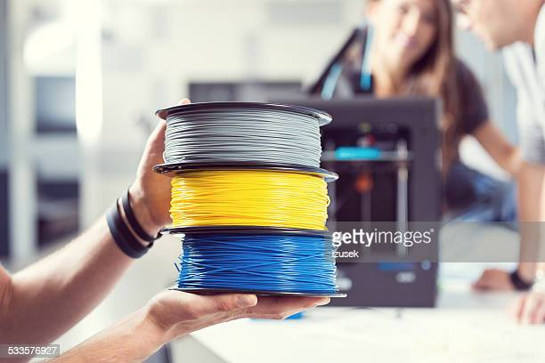 Plastic filaments in 3D printer office